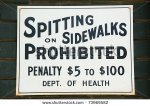 stock-photo-spitting-on-sidewalks-prohibited-sign-on-a-brick-wall-73969582
