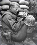 In the midst of the Korean War, this solider cares for a newborn kitten.